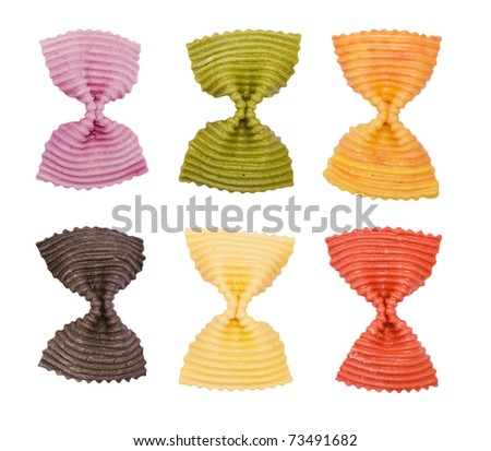 Multi colored pasta on a white background