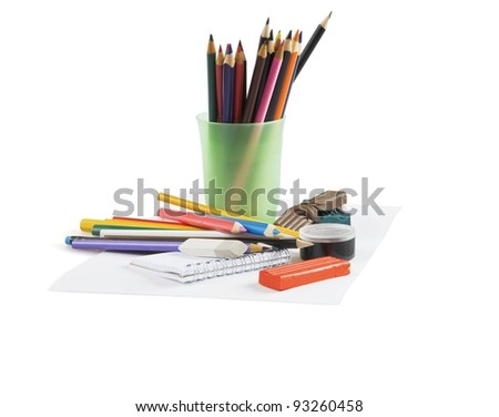Multi-colored pencils in a glass on a white background