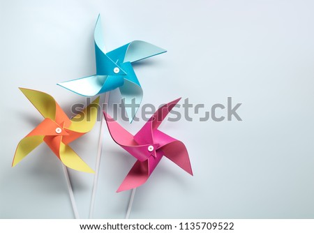Photo of  Multi colored pinwheel on paper background