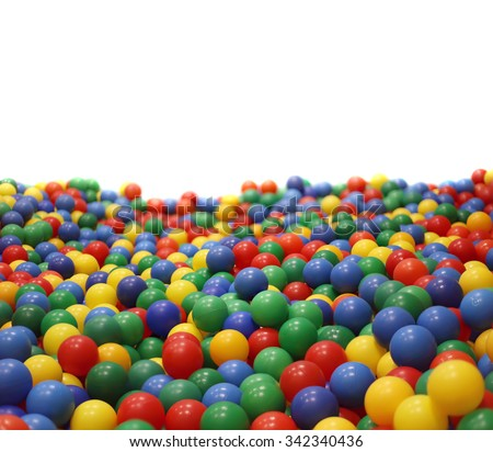 Multi-colored plastic balls. A  children\'s playroom.  isolated on  white background.