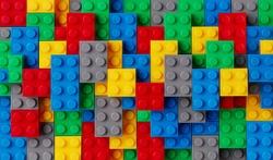 Multi-colored plastic blocks background closeup
