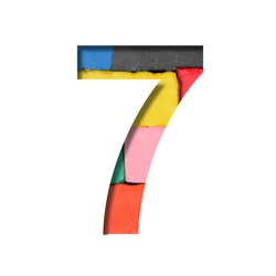 Multi-colored plasticine font. The digit seven, 7 is cut out of paper on a background with a piece of colored plasticine. Set of colored fonts.