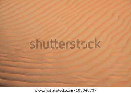 Multi-colored ripples of orange and yellow sand in the desert near Liwa Oasis, United Arab Emirates