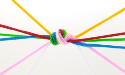 Multi-colored rope tied concept business unity.