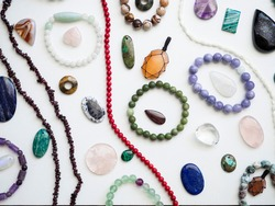 Multi-colored semiprecious stones on a white background