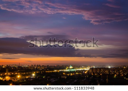 Multi-colored sky with clouds at sunset over the night city #111833948
