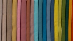 Multi-colored strips of fabric, samples of textile material. Soft fleecy fleece, a palette of color shades. Backdrop wallpaper background