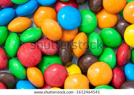 Multi-colored sweet candies (confectionery) of different colors. abstract background.