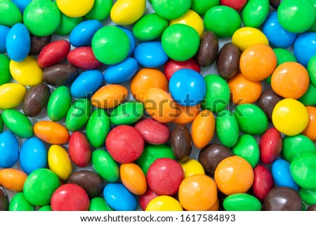 Multi-colored sweet candies (confectionery) of different colors. Colorful abstract background.
