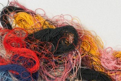 multi-colored thread for sewing clothes tangled abstract