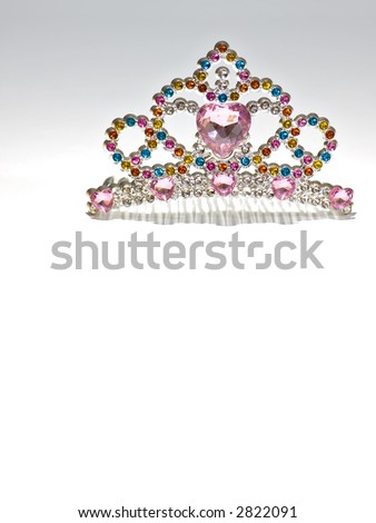 Multi colored tiara isolated on gradient background. Costume jewelry.