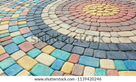 multi-colored tiles paving #1139420246