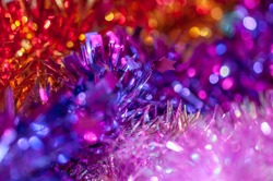 Multi-colored tinsel in the bokeh. New Year