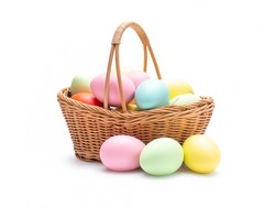 Multi colors Easter eggs in the woven basket isolated on white background with clipping path. Pastel color Easter eggs.