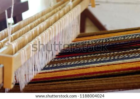 Multi-coloured blanket on old fashioned wool loom