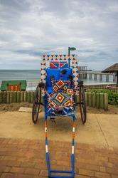 Multi-coloured decorated wheel of rickshaw vehicle in Durban,South Africa