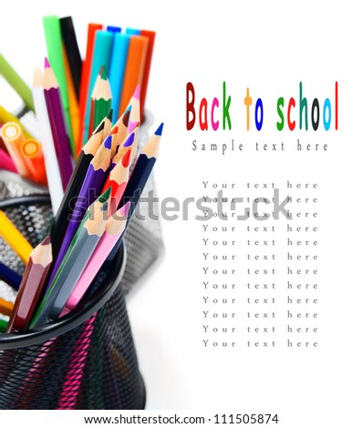 Multi-coloured pencils and felt-tip pens in baskets.