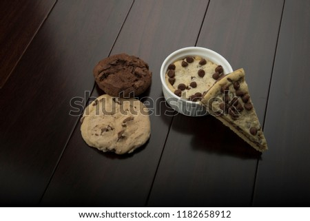 multi cookies like pizza cookies and chocolate cookie and vanilla cookie , with cup cookie  #1182658912