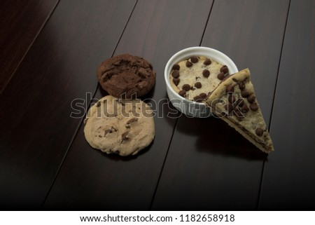 multi cookies like pizza cookies and chocolate cookie and vanilla cookie , with cup cookie  #1182658918