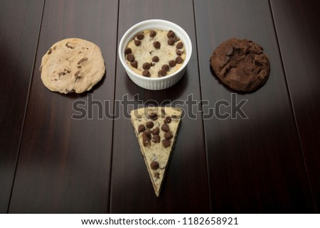 multi cookies like pizza cookies and chocolate cookie and vanilla cookie , with cup cookie  #1182658921