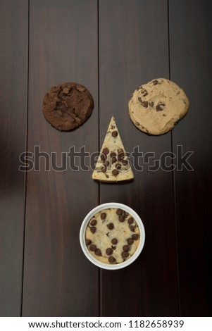 multi cookies like pizza cookies and chocolate cookie and vanilla cookie , with cup cookie  #1182658939