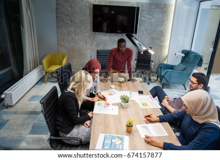Multi-Cultural Office Staff Sitting Having Meeting Together #674157877
