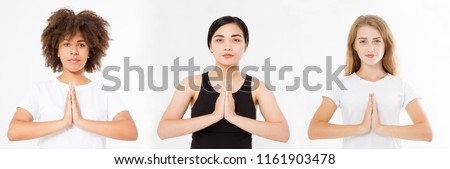 Multi-ethnic beauty. Different ethnicity women - Caucasian,African, Asian. Close-up of hands of european, black and korean girl, focus on arms in Namaste gesture.Interracial concept. Copy space.