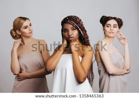 Multi-Ethnic beauty or interracial friendship. Different ethnicity women - on white background