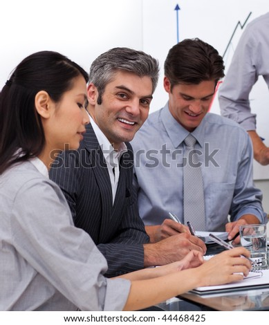 Multi-ethnic business co-workers in a meeting. Business concept. - stock photo