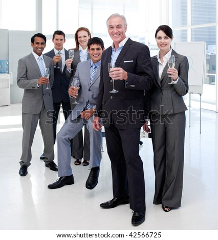 Multi-ethnic business people celebrating a success with Champagne