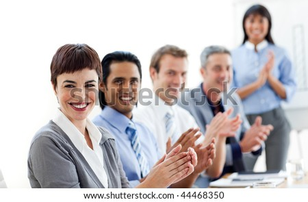Multi-ethnic business people clapping a good presentation against a white background