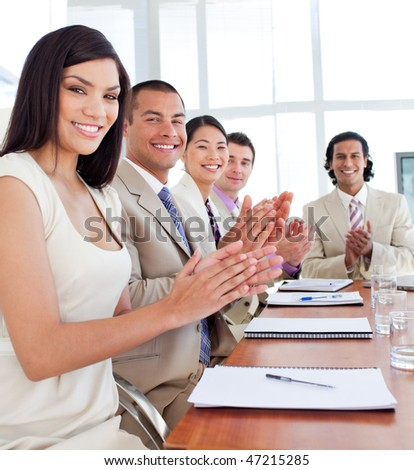 Multi-ethnic business team applauding after a conference in a company #47215285