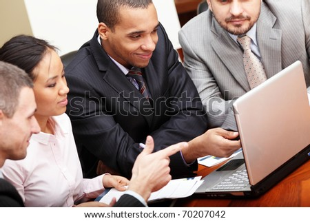 Multi ethnic business team at a meeting