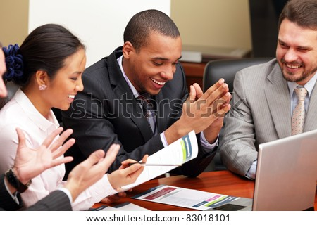 Multi ethnic business team at a meeting. Interacting. Focus on african-american man stock photo