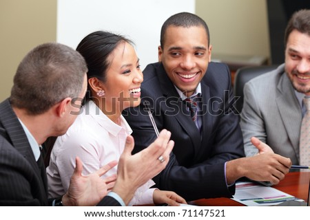 Multi ethnic business team at a meeting. Interacting. Focus on woman stock photo