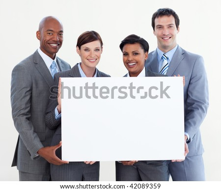 Multi-ethnic business team holding white card isolated on white background