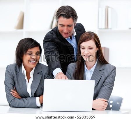 Multi-ethnic business team working at a computer in the office