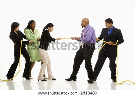 Multi-ethnic businessmen  playing tug of war against businesswomen.
