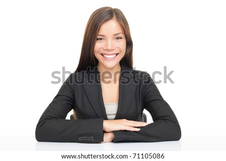 Multi ethnic businesswoman smiling sitting at her desk. Beautiful young model isolated on white background.