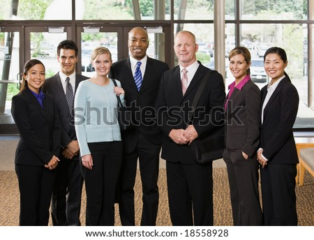 Multi-ethnic co-workers posing in office lobby