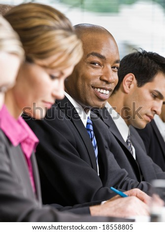 Multi-ethnic co-workers sitting in a row