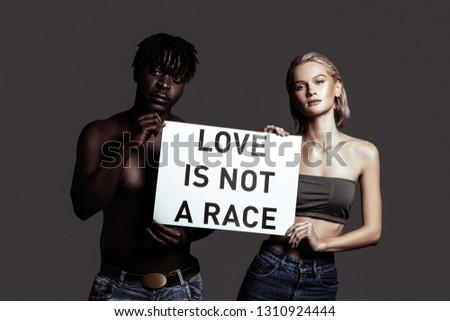 Multi-ethnic diversity. Couple of models representing multi-ethnic diversity protecting their love #1310924444