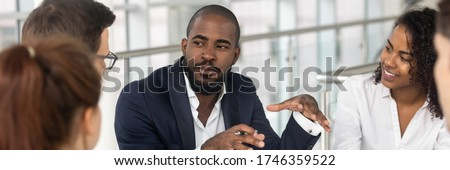 Multi ethnic employees involved in corporate training in boardroom, african team leader company boss business coach leading seminar activity concept. Horizontal photo banner for website header design