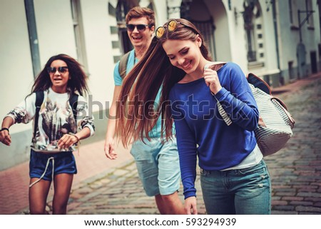 Multi ethnic friends tourists in an old European city. #593294939
