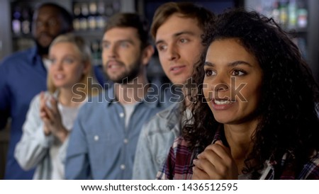 Multi-ethnic girl with friends rooting for national team, event audience #1436512595