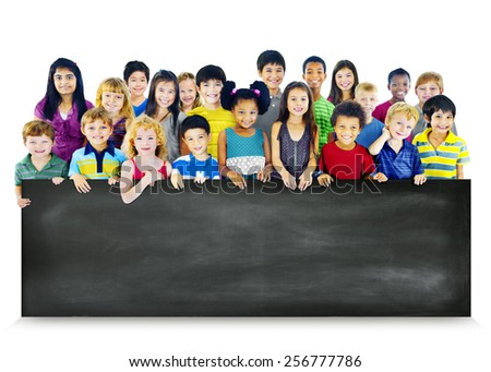 Multi-Ethnic Group of Children Holding Empty Blackboard