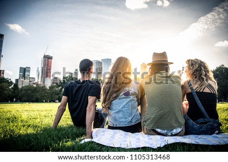Multi-ethnic group of friends in Central Park, Manhattan - Young cheerful people bonding outdoors #1105313468
