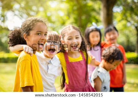 Multi-ethnic group of school children laughing and embracing #1458542015