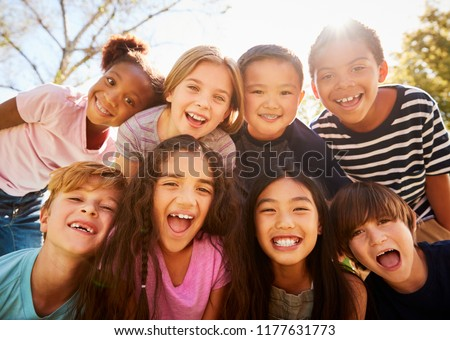 Multi-ethnic group of schoolchildren on school trip, smiling #1177631773