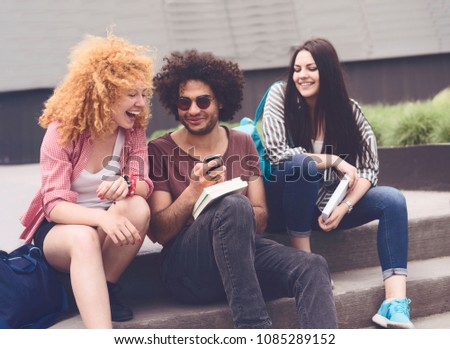 Multi-ethnic group of young students having fun at university campus #1085289152